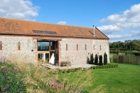 Five luxury award winning barns close to Holkham and Wells-next-the-Sea, Norfolk.