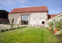 Seven luxury award winning barns close to Holkham and Wells-next-the-Sea, Norfolk.